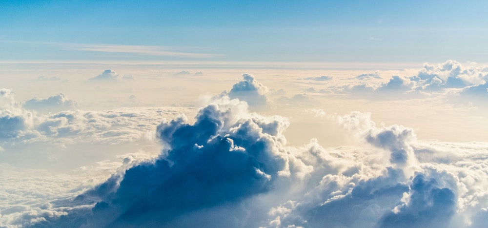 A beautiful shot of fluffy clouds taken from above.