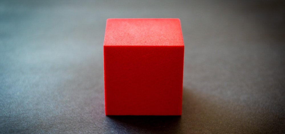 A red block on a grey background.